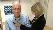 A doctor examines a senior
