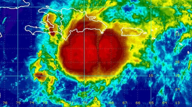 Tropical Storm Emily moves toward the Dominican Republic and Haiti as seen in this enhanced NOAA satellite image taken at 10:15 p.m. ET, Wednesday, Aug. 3, 2011.