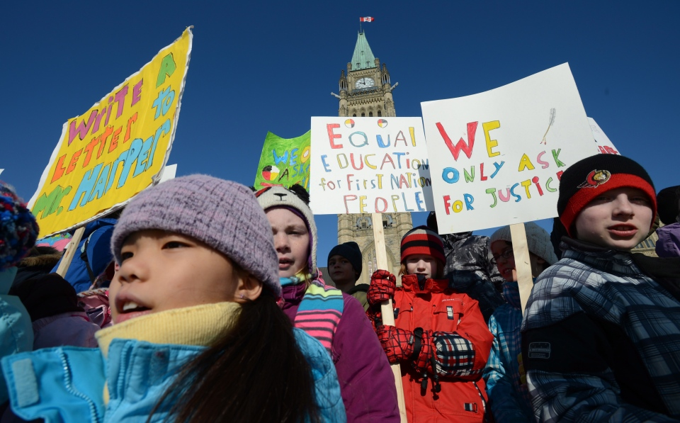 Children take part in a protest on Parliament Hill in Ottawa on Feb. 14, 2013 calling for equal education for First Nations. (THE CANADIAN PRESS / Sean Kilpatrick)