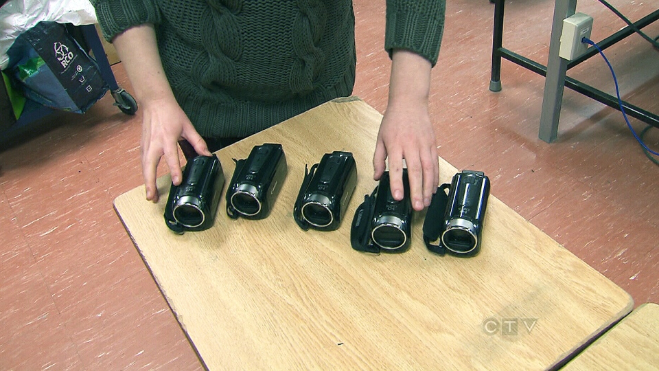 Rachel Rosen, a teacher at Lester B. Pearson Collegiate Institute in Scarborough, shows off five video cameras she was able to purchase for her class through fundraising on myclassneeds.ca, Thursday, Dec. 12, 2013.