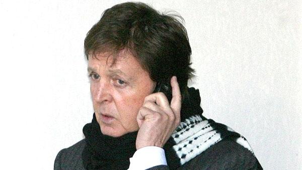 Sir Paul McCartney on his mobile phone in London Feb 11 2008. (AP / Dominic Lipinski/ PA, file)