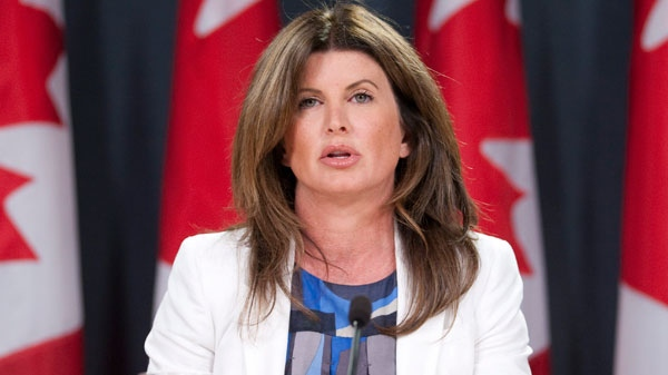 Minister of Public Works and Government Services and Minister for Status of Women Rona Ambrose speaks during a news conference in Ottawa, Thursday August 4, 2011. (Adrian Wyld / THE CANADIAN PRESS)