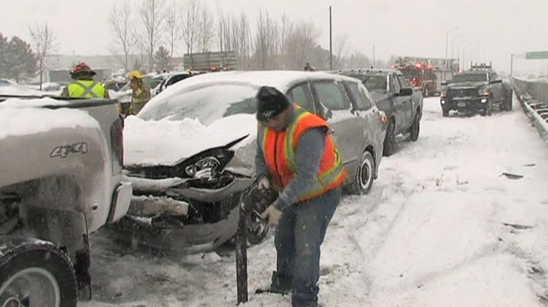 A car is seen after a collision on the QEW in Mississauga, Ont. on Saturday, Dec. 14, 2013.