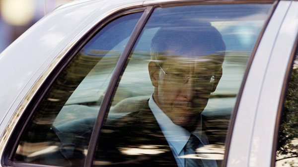 Warren Jeffs looks out the back of a Tom Green County Sheriff's Department car, after leaving the Tom Green County Courthouse, in San Angelo, Texas, Thursday, Aug. 4, 2011. (AP / San Angelo Standard-Times, Patrick Dove)