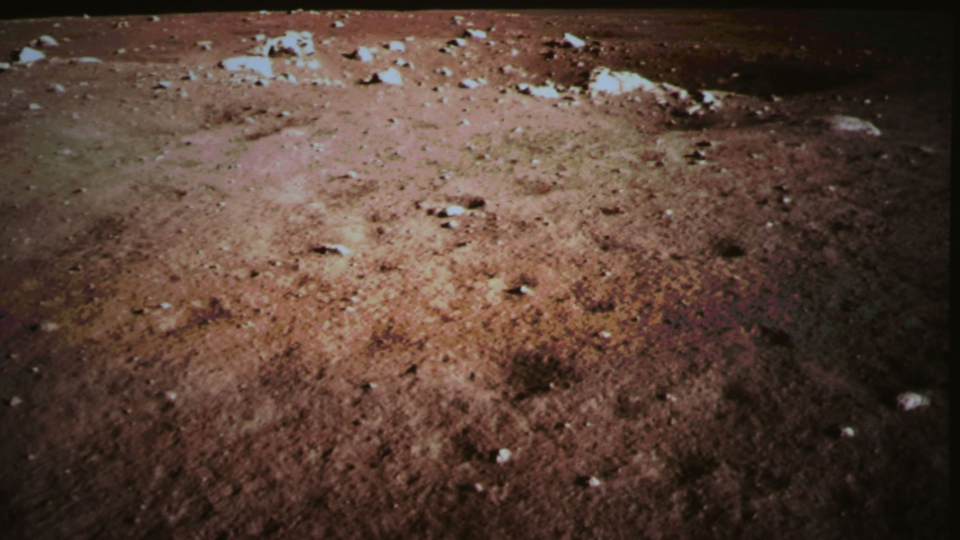 A picture of the moon surface is shown, taken by the on-board camera of the lunar probe Chang'e-3 on the screen of the Beijing Aerospace Control Center in Beijing, China, Saturday, Dec. 14, 2013. (Xinhua, Wang Jianmin)