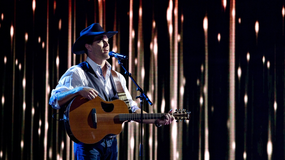 George Canyon performs during the Canadian Country Music Awards in Edmonton, Alberta on Sunday September 8, 2013. (Jason Franson/The Canadian Press)