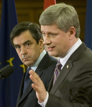 Prime Minister Stephen Harper and French Prime Minister Francois Fillion respond to reporters' questions following their meeting on Parliament Hill in Ottawa, Wednesday, July 2, 2008. (Tom Hanson / THE CANADIAN PRESS)