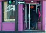 A man enters a massage parlour in Montreal on Dec. 13, 2013. (Ryan Remiorz / THE CANADIAN PRESS)