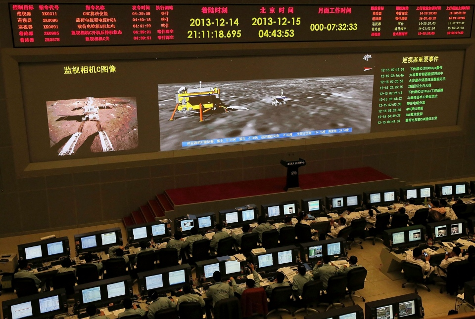 Researchers work in the control room of the Chang'e-3 lunar probe after it landed on the moon and deployed a moon rover, at the Beijing Aerospace Control Center in Beijing. (AP)