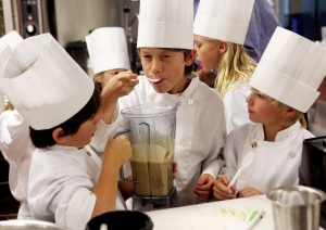 Oliver Chantler, 7, left, and Fletcher Holm, 8, right, wait for their teammate, Ethan Pope's, 8, center, taste verdict on their Pad Thai peanut sauce Oct. 13, 2010. (AP Photo/Vail Daily, Dominique Taylor)