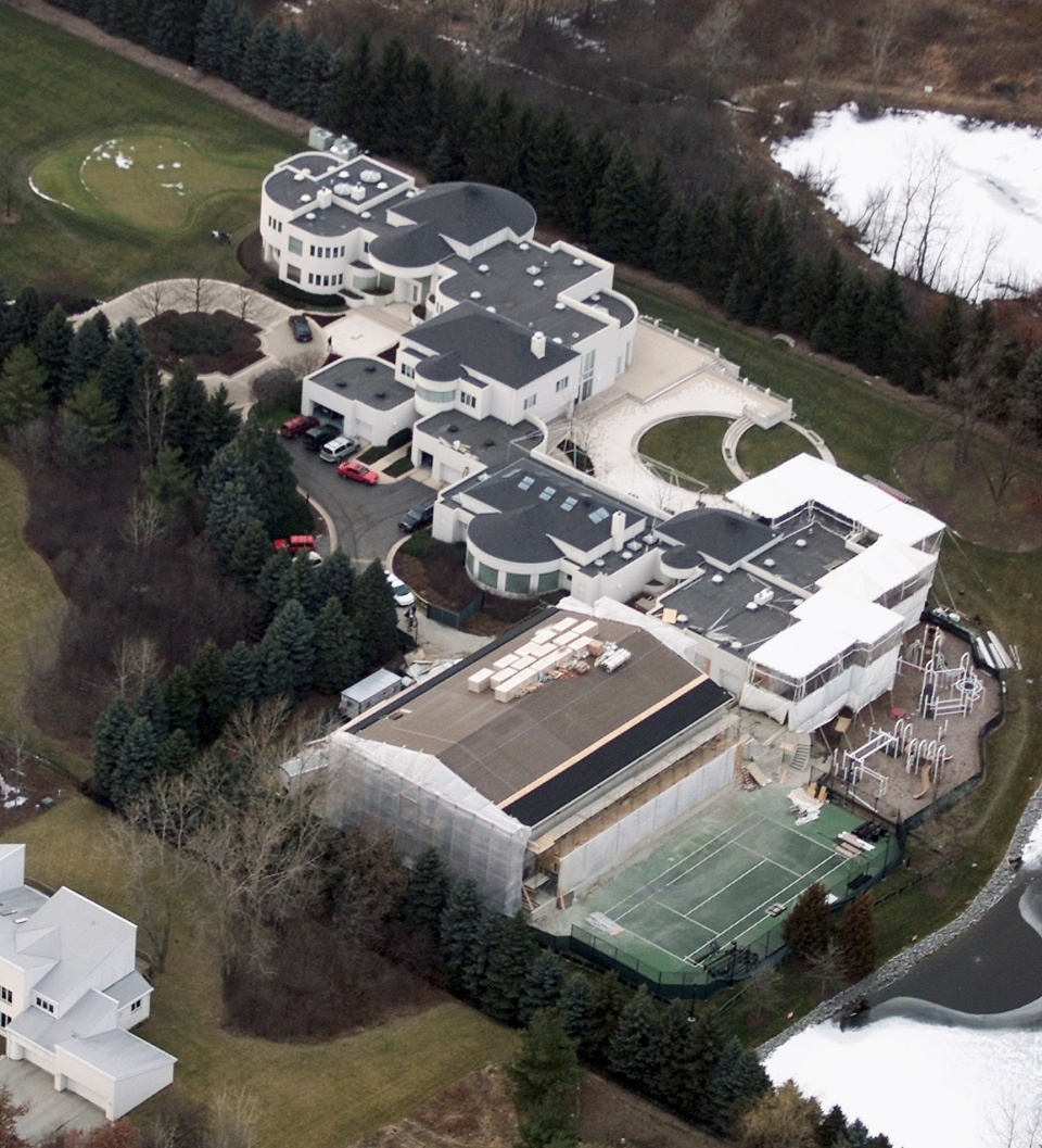 This Jan. 8, 2002 aerial file photo shows the home of former Chicago Bulls star Michael Jordan, in Highland Park, Ill. Jordan's 56,000-square foot home in suburban Chicago is up for auction. Concierge Auctions says the sale will take place Monday, Dec. 16, 2013.  (AP Photo/Ted S. Warren, File)