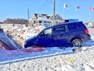 A minivan crashed into a construction trench on Fischer-Hallman Road in Kitchener, Ont., on Monday, Dec. 16, 2013. (Dan Lauckner / CTV Kitchener)
