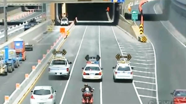 This police convoy led traffic through a section of the highway that had been closed for six days.