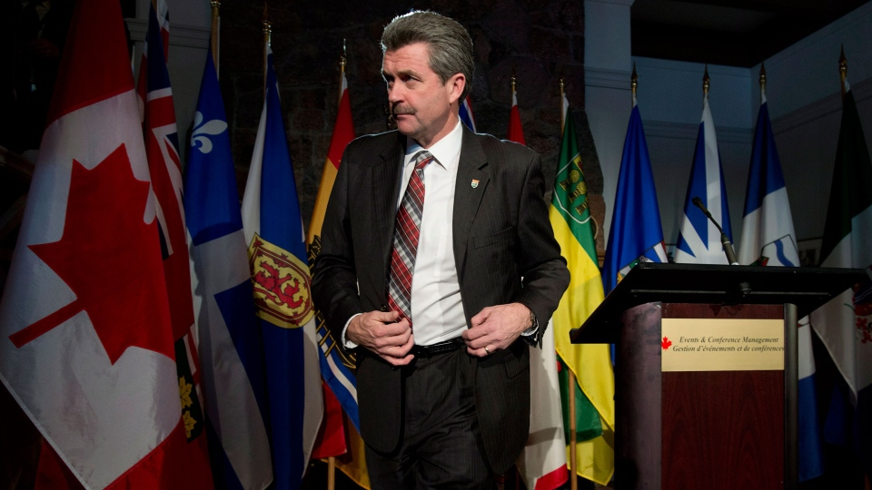 Prince Edward Island Finance Minister Wes Sheridan leaves the podium after speaking with the media following federal-provincial Finance ministers meetings  in Chelsea, Que. on Monday Dec.16, 2013. (Adrian Wyld / THE CANADIAN PRESS)