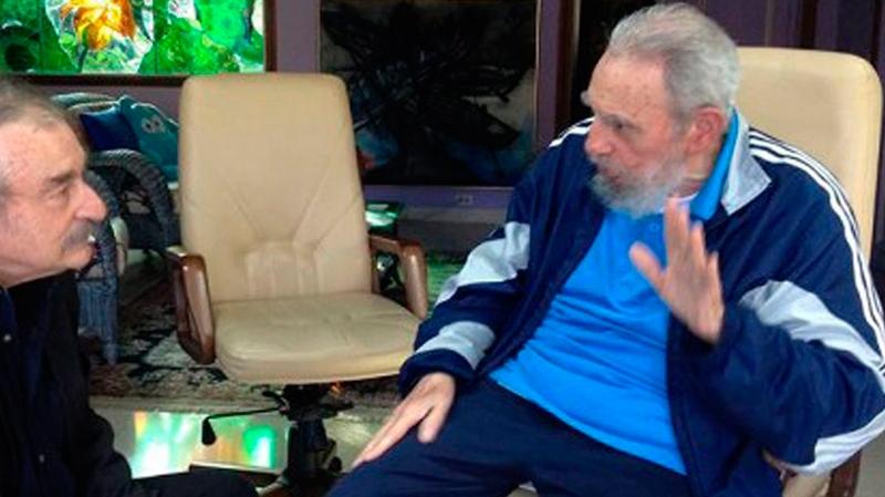 In this Dec. 13, 2013 photo released by the Cubadebate website, Cuban leader Fidel Castro, right, talks with Ignacio Ramonet in Havana, Cuba. (AP Photo/Granma, Estudios Revolucion)