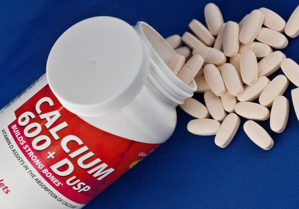 A photo illustration shows a container of over the counter calcium supplements. (AP / Bebeto Matthews)