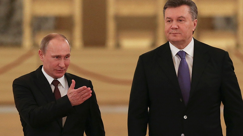 Russian President Vladimir Putin, left, shows the way to his Ukrainian counterpart Viktor Yanukovych during a meeting in the Kremlin in Moscow, Russia, Tuesday, Dec. 17, 2013. (AP / Sergei Karpukhin)
