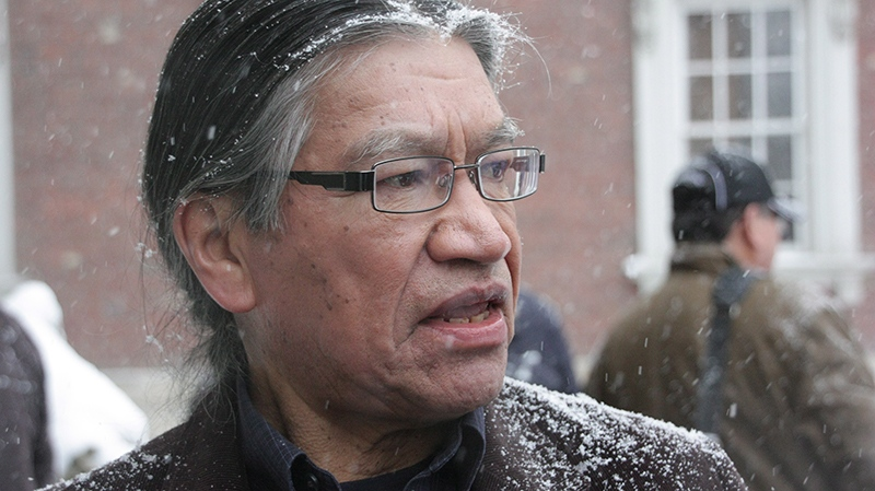 Edmund Metatawabin, 66, a survivor of St. Anne's residential school in Fort Albany, Ont., is seen outside Osgoode Hall in Toronto on Tuesday, Dec.17, 2013. (Colin Perkel / THE CANADIAN PRESS)