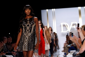 This Sept. 8, 2013 file photo shows model Naomi Campbell walking the runway in the Diane von Furstenburg Spring 2014 collection show during Fashion Week in New York. (AP Photo/Jason DeCrow, File)