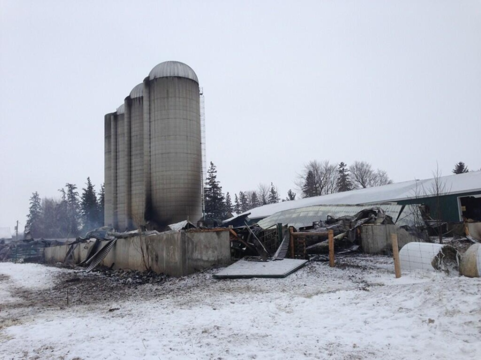 Smoke can still be seen after an early morning barn fire near Thamesford in Oxford County, Ont. on Tuesday, Dec. 17, 2013. (Bryan Bicknell / CTV London)
