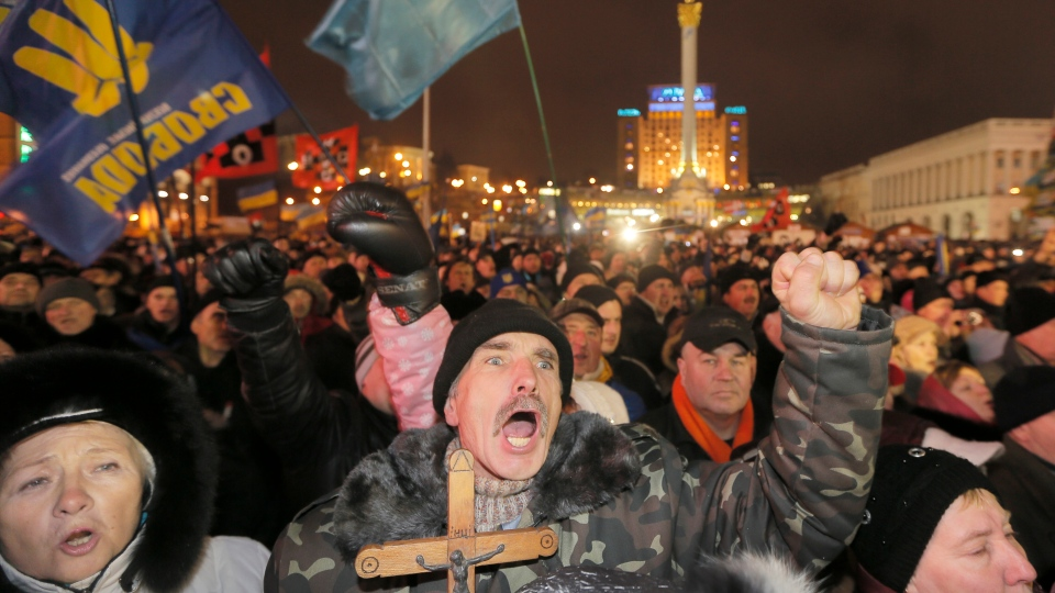 Pro-European Union activists gather during a rally in Independence Square in Kiev, Ukraine, Tuesday, Dec. 17, 2013. (AP / Efrem Lukatsky)