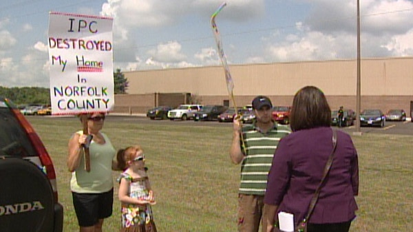 Protesters fighting against wind turbines stand outside the Siemens plant in Tillsonburg, Ont. on Monday, Aug. 8, 2011.