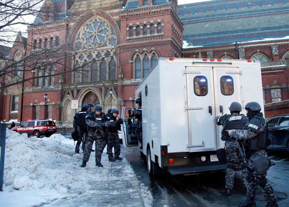 SWAT team officers arrive at a building at Harvard University in Cambridge, Mass., Monday, Dec. 16, 2013. (AP / Elise Amendola)