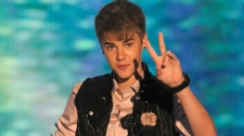 Justin Bieber accepts the award for choice music: male artist at the Teen Choice Awards in Universal City, Calif., Sunday, Aug. 7, 2011. (AP / Chris Pizzello)