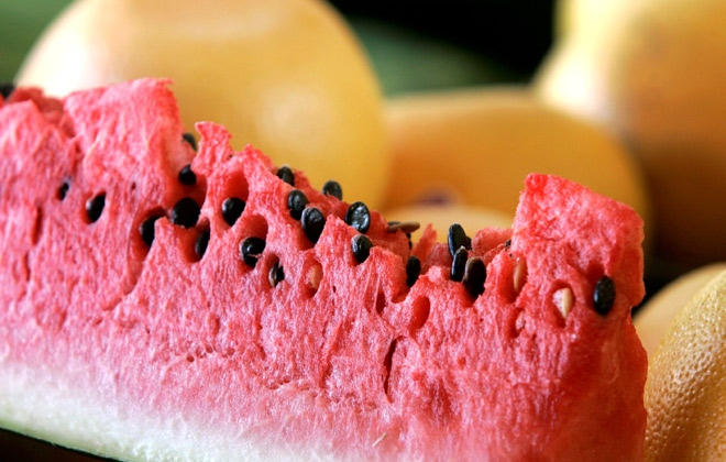 A slice of watermelon is shown at the Gutierrez Produce stand at the Dallas Farmers Market, Tuesday, July 1, 2008.  (AP / Tony Gutierrez)