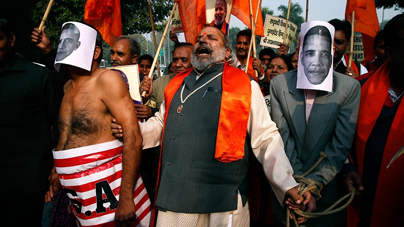 Supporters of right wing Rashtrawadi Shivsena, or nationalist soldiers of Shiva, protest against the alleged mistreatment of New York based Indian diplomat Devyani Khobragade, in New Delhi, India, Wednesday, Dec. 18, 2013.  (AP / Saurabh Das)