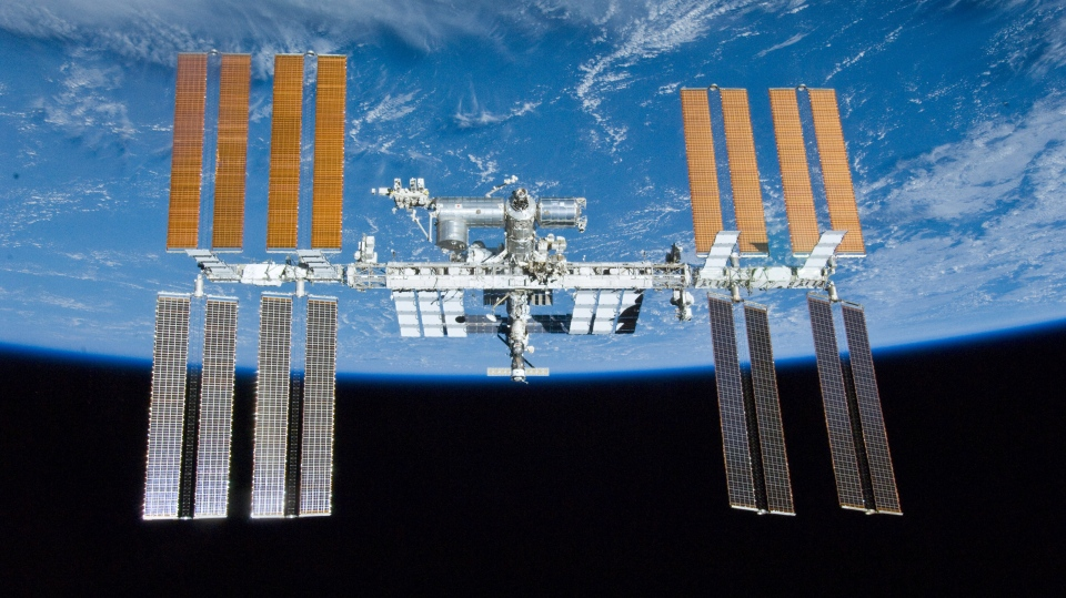 This May 23, 2010 image provided by NASA shows the International Space Station with the Earth in the background. (NASA)