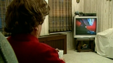 Woman watching TV. (file)