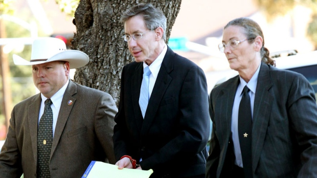 Warren Jeffs is taken into the side entrance of the Tom Green County Courthouse, Monday, Aug. 8, 2011 in San Angelo, Texas. (AP / San Angelo Standard-Times, Patrick Dove)