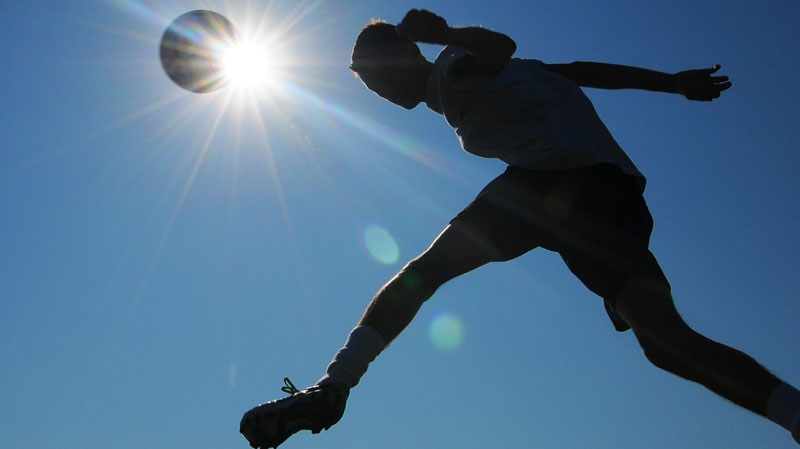 In this July 20, 2011 file photo, a member of the Salina South High School soccer team works out for conditioning training in Salina, Kansas. (AP / Salina Journal, Tom Dorsey)