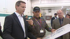 Ontario Premier Dalton McGuinty tours the Siemens Canada plant in Tillsonburg, Ont. on Monday, Aug. 8, 2011.