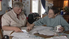 David and Marian Baker look over their hydro bills
