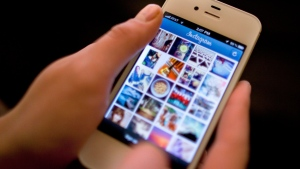 Instagram is demonstrated on an iPhone in this April 9, 2012 file photo. (AP / Karly Domb Sadof)