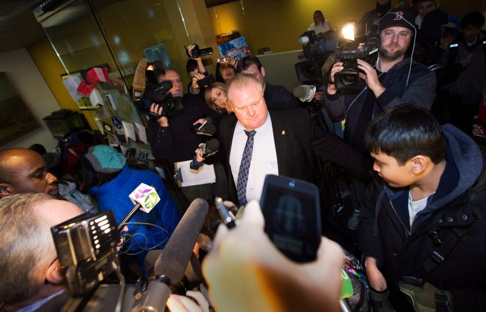 Toronto Mayor Rob Ford arrives at city hall as he clears a path for school children into his office in Toronto, Friday, Dec. 13, 2013. (Mark Blinch / THE CANADIAN PRESS)