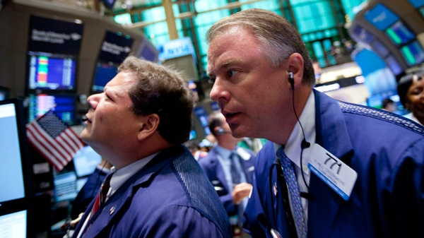 Traders work on the floor of the New York Stock Exchange in New York on Monday, Aug. 8, 2011. (AP / Jin Lee)