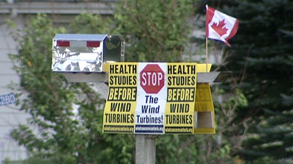 Signs protesting wind turbines are seen in West Perth, Ont. on Monday, Aug. 8, 2011.