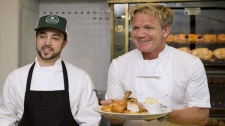 Chef Gordon Ramsay, right, passes out some food during a cooking demonstration at his new restaurant 'Laurier Gordon Ramsay', in Montreal, Tuesday, August 9, 2011, as head chef Guillermo Russo looks on. THE CANADIAN PRESS/Graham Hughes