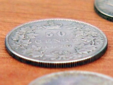 This counterfeit coin is made to look like it was minted in 1879.