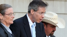 Convicted polygamist leader Warren Jeffs is escorted from the Tom Green County Courthouse in San Angelo, Texas, Monday, Aug. 8, 2011. (San Angelo Standard-Times / Patrick Dove)