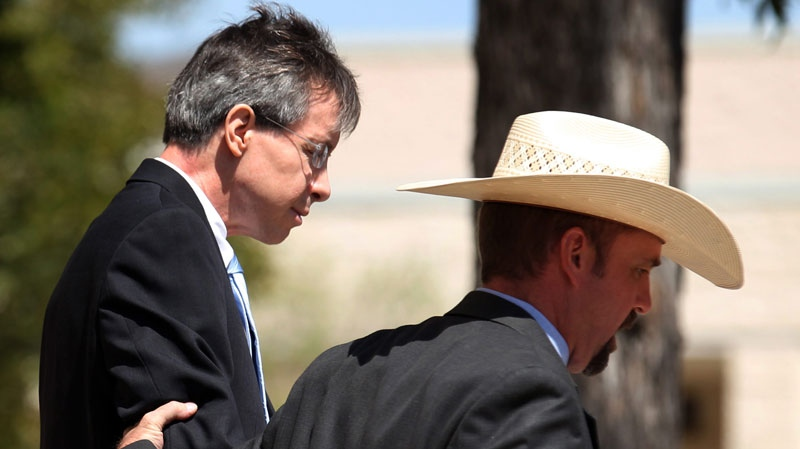 Warren Jeffs, leader of the Fundamentalist Church of Jesus Christ of Latter Day Saints, left, is led out of the Tom Green County Courthouse in San Angelo, Texas on Tuesday, Aug. 9, 2011. (AP / The San Angelo Standard-Times, Patrick Dove)