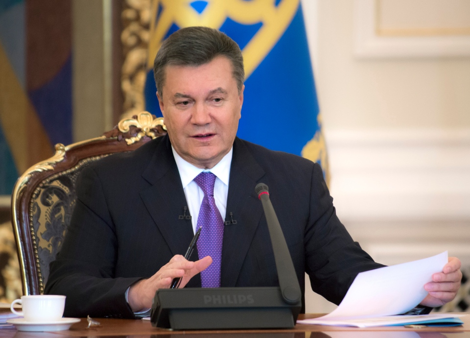 Ukraine's acting government issued a warrant Monday for the arrest of President Viktor Yanukovych, seen here in Kyiv in December.