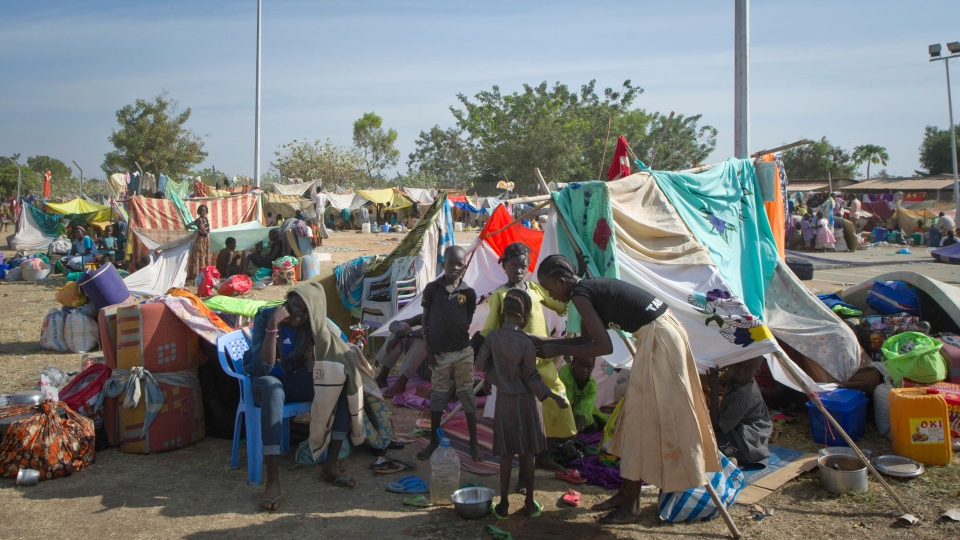 A displaced family sits with their belongings after seeking refuge at the compound of the United Nations Mission in South Sudan (UNMISS), in Juba, South Sudan Thursday, Dec. 19, 2013. (AP)