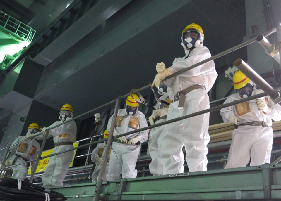 In this Wednesday, Sept. 25, 2013 photo released by the International Research Institute for Nuclear Decommissioning, members of International Expert Group (IEG) inspect the crippled Fukushima Dai-ichi nuclear power plant in Okuma, Fukushima Prefecture, northeast of Tokyo, during the first IEG meeting held from Sept. 23 - 27. (AP / The International Research Institute for Nuclear Decommissioning)