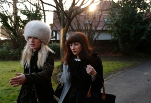 Italian sisters Francesca, centre, and Elisabetta Grillo, obscured behind her, former personal assistants of English broadcaster Nigella Lawson and her former husband art collector Charles Saatchi, arrive at the Isleworth Crown Court, in west London, Friday, Dec. 20, 2013, during a trial over alleged fraud. . (AP Photo/Lefteris Pitarakis)