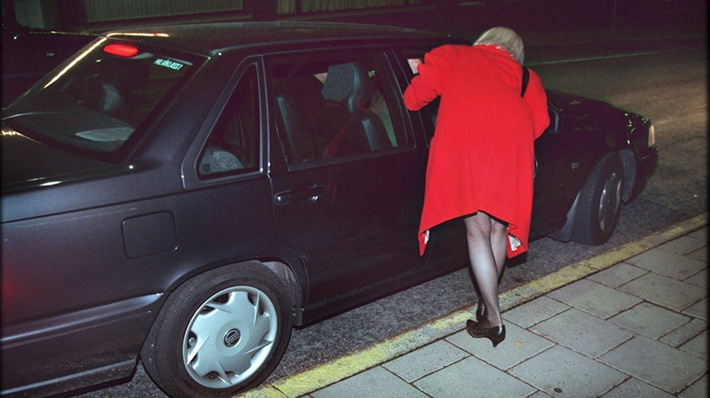Undated file photo of an unidentified prostitute talking to someone in a car at Malmskillnadsgatan street in central Stockholm, Sweden. (AP Photo/Claudio Bresciani )