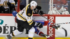 Montreal Canadiens' Max Pacioretty is hit by Boston Bruins' Zdeno Chara during second  period NHL hockey action in Montreal on March 8, 2011. (Paul Chiasson / THE CANADIAN PRESS)